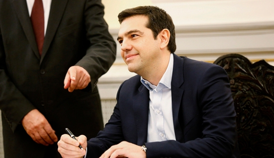Alexis Tsipras, Syriza party leader and winner of the Greek parliamentary elections, signs papers appointing him as Greece's first leftist prime minister after his swearing-in ceremony at the presidential palace in Athens January 26, 2015. REUTERS/Yannis Behrakis (GREECE - Tags: POLITICS ELECTIONS) - RTR4MZDP