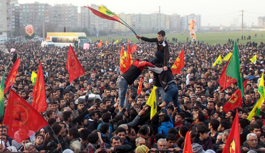 People gather to celebrate in the Kurdish-dominated city of Diyarbakir in southeastern Turkey, after Kurdish forces said they took full control of the Syrian town of Kobani, January 27, 2015. Kurdish forces battled Islamic State fighters outside Kobani on Tuesday, a monitoring group said, a day after Kurds said they took full control of the northern Syrian town following a four-month battle. REUTERS/Sertac Kayar (TURKEY - Tags: POLITICS CIVIL UNREST CONFLICT) - RTR4N6SW