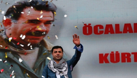 Demirtas, co-chairman of the pro-Kurdish Peace and Democracy Party, greets his supporters during a rally to celebrate the spring festival of Newroz in Istanbul