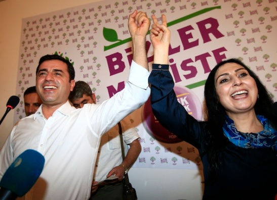 "Selahattin Demirtas, left, co-chair of the pro-Kurdish Peoples' Democratic Party, (HDP) and Figen Yuksekdag, the other co-chair celebrate following a news conference in Istanbul, Turkey, late Sunday, June 7, 2015. In a stunning blow to President Recep Tayyip Erdogan, preliminary results from Turkey's parliamentary election on Sunday suggested that his party could lose its simple majority in Parliament. Demirtas called his party's ability to cross the threshold a ""fabulous victory for peace and freedoms"" that came despite the attack on his party and fierce campaigning by Erdogan. (AP Photo/Lefteris Pitarakis)"