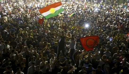Supporters celebrate outside the pro-Kurdish Peoples' Democratic Party (HDP) headquarters in Diyarbakir, Turkey, June 7, 2015. (photo by REUTERS/Osman Orsal) Read more: http://www.al-monitor.com/pulse/originals/2015/06/turkey-elections-what-next-coalitions-akp-chp-hdp.html#ixzz3cdenaf7d