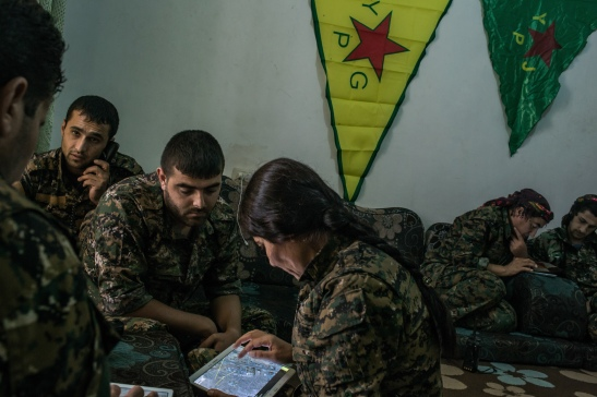 To follow a story on YPG fighters striking ISIS position by Rukmini Callimachi - Hasaka, Syria - July 31, 2015: YPG fighters check maps and location as they coordinate one air strike on ISIS position inside Hasaka, at a YPG headquarters on the outskirts of Hasaka. CREDIT: Photo by Mauricio Lima for The New York Times                              NYTCREDIT: Mauricio Lima for The New York Times