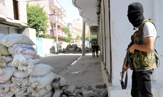 An armed Kurdish militant stands near a barricade in the Turkish town of Cizre in Sirnak province, near the border with Syria. Photograph: STRINGER/TURKEY/Reuters